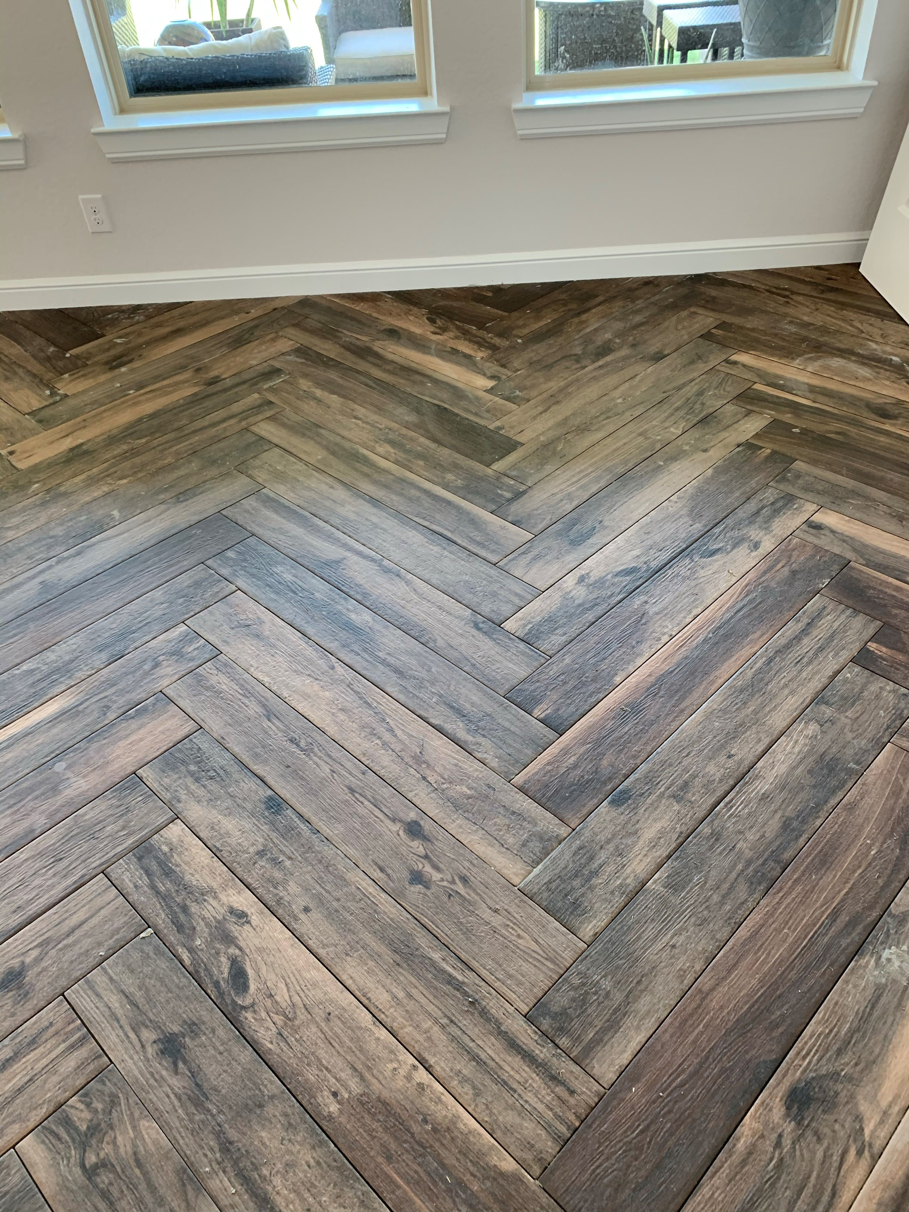 wood look tile in a herringbone patter